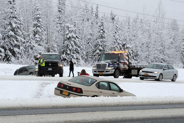 Pictured: Motorists await assistance after sliding off the Glenn Highway midday Monday, Nov. 2, 2015, near the JBER-Richardson overpass.
