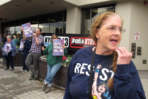 Shoshanah Stone, with the grassroots group Indivisible Anchorage, participates in a protest organized by her group outside U.S. Sen. Lisa Murkowski's office Monday, July 9, 2018, in Anchorage, Alaska. Protesters rallied to urge Murkowski to vote against President Donald Trump's Supreme Court nominee. (AP Photo/Rachel D'Oro)