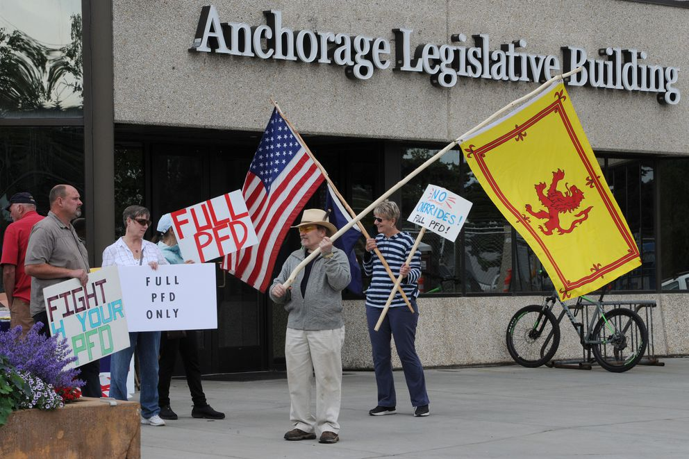 Protestors who support a full PFD stand outside the Anchorage Legislative Building before public testimony in the Alaska House Finance Committee meeting on Monday, July 15, 2019. (Bill Roth / ADN)