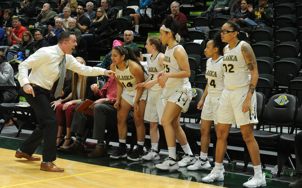 UAA coach Ryan McCarthy and the UAA bench reacts to a play during Saturday's 76-68 win. (Bob Hallinen / ADN)
