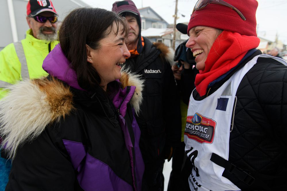 Jessie Royer, left, and Aliy Zirkle talk after Zirkle reached Nome. Royer placed third, and Zirkle placed fourth in the Iditarod. Iditarod musher Aliy Zirkle reached Nome in fourth place on March 13, 2019. (Marc Lester / ADN)
