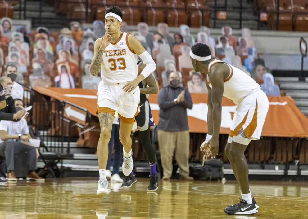 Kamaka Hepa gestures to his Texas teammate during Saturday's win over Kansas State. (Stephen Spillman / Courtesy University of Texas Athletics)
