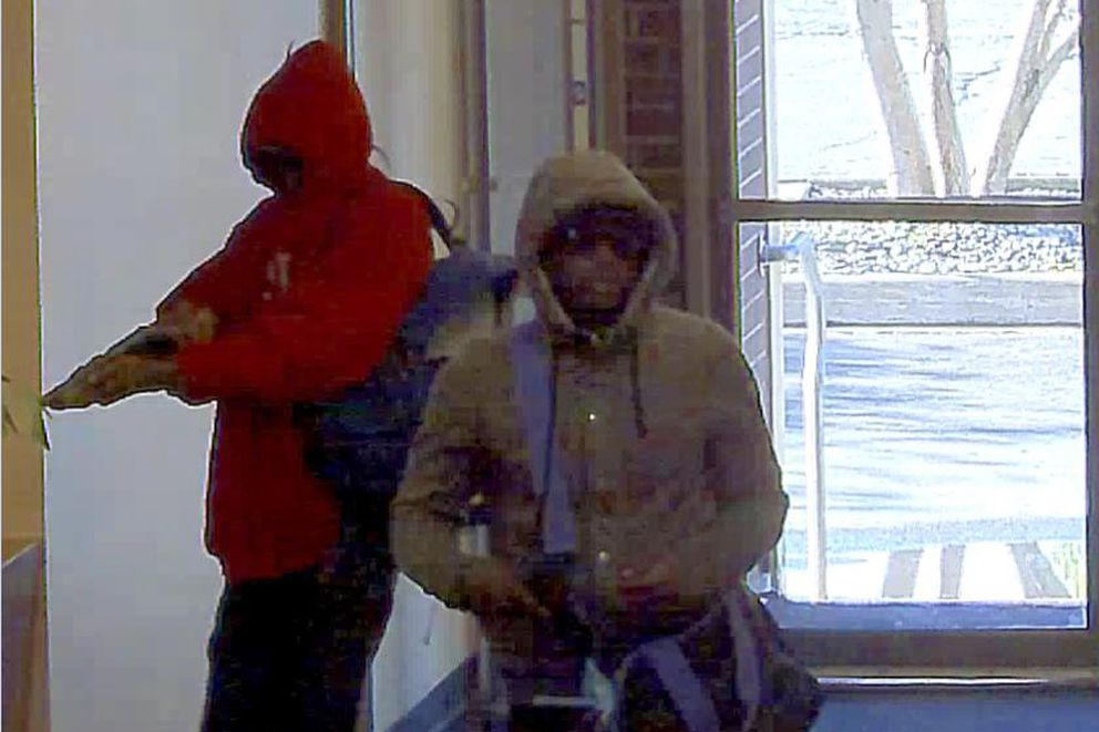 Surveillance images from the Wells Fargo bank on East 5th Avenue show an armed robbery on Aug. 18, 2016. (Photo provided by FBI)