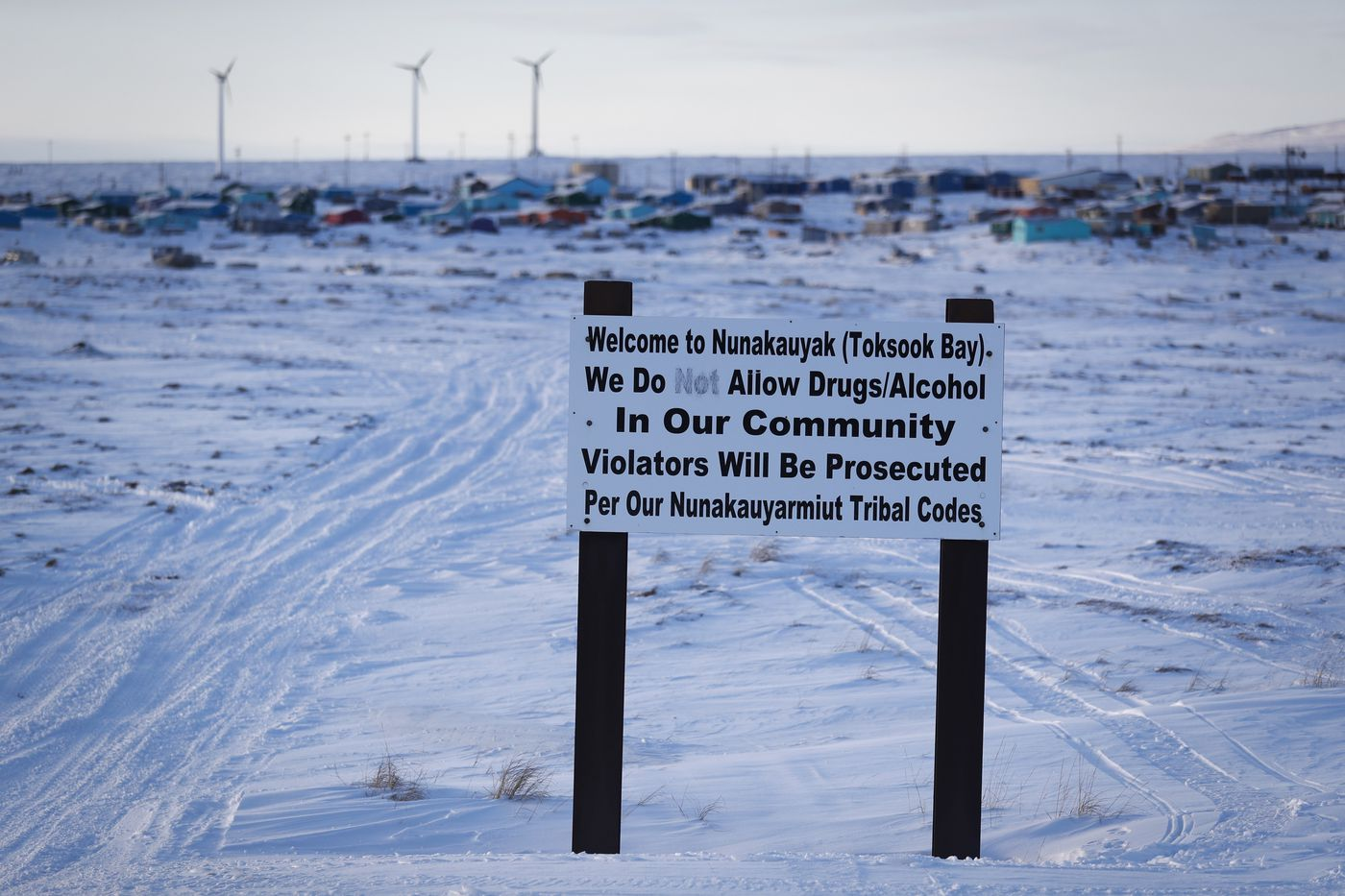 A sign displays rules Saturday, Jan. 18, 2020, in Toksook Bay, Alaska. The first Americans to be counted in the 2020 Census starting Tuesday, Jan. 21, live in this Bering Sea coastal village. The Census traditionally begins earlier in Alaska than the rest of the nation because frozen ground allows easier access for Census workers, and rural Alaska will scatter with the spring thaw to traditional hunting and fishing grounds. (AP Photo/Gregory Bull)