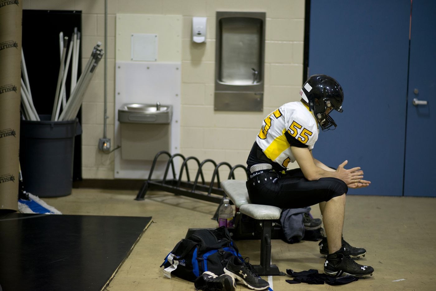 Voznesenka offensive and defensive lineman Nik Anufriev takes a moment to himself before a game at Nikiski on Sept. 2. (Marc Lester / Alaska Dispatch News)