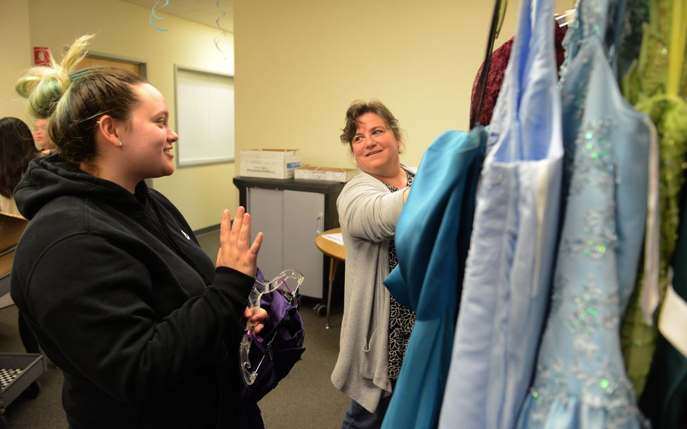 Emalee Kramer looks for a prom dress with the help of Katy Grant at Becca's Closet in Anchorage on Saturday April 21, 2018. (Bob Hallinen / ADN)