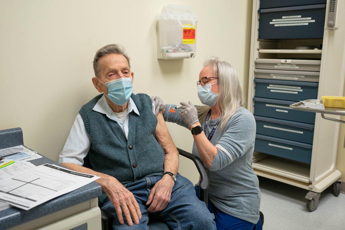 World War II veteran Herbert Worthley, 94, receives his first dose of the Moderna COVID-19 vaccine from Registered Nurse Geri Finn at the Anchorage VA Medical Center on Saturday, Jan. 23, 2021. (Loren Holmes / ADN)