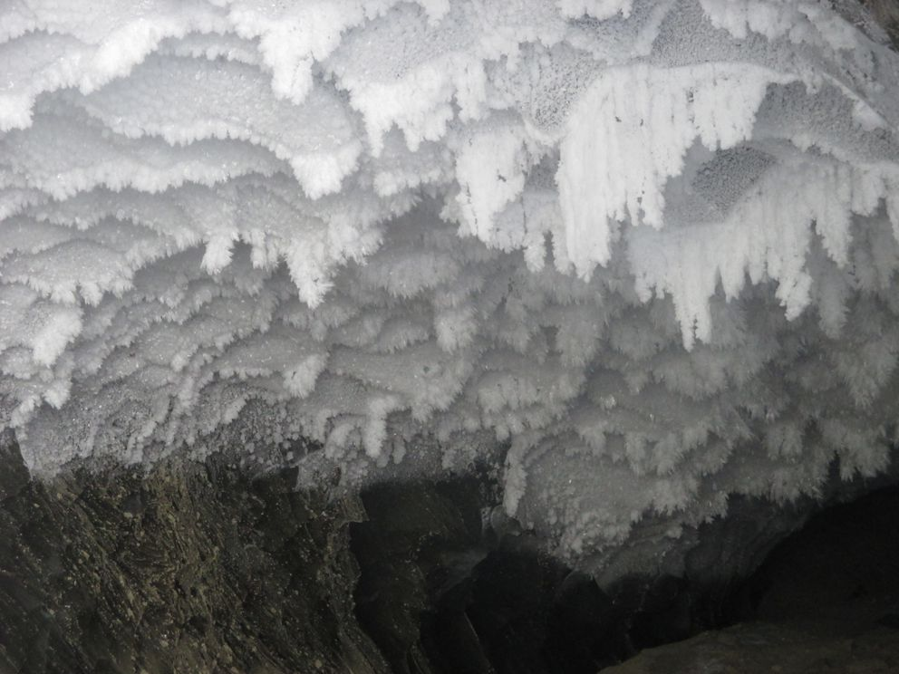 Ice crystals hang just inside the entrance of an ice cave in Canwell Glacier. (Photo by John Schandelmeier)