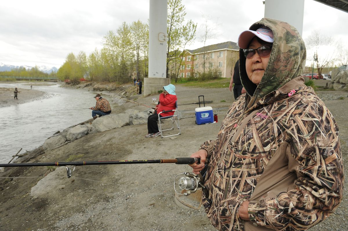 Janet Grow of Wasilla fishes for king salmon from the bank of Ship Creek on Wednesday. (Bob Hallinen / Alaska Dispatch News)