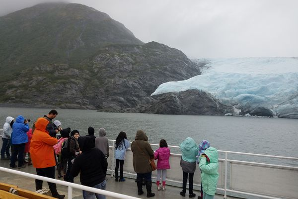 Students from Creekside Elementary in Anchorage look at Portage Glacier from the deck of the m/v Ptarmigan during a field trip. (Photo by Erin Kirkland)