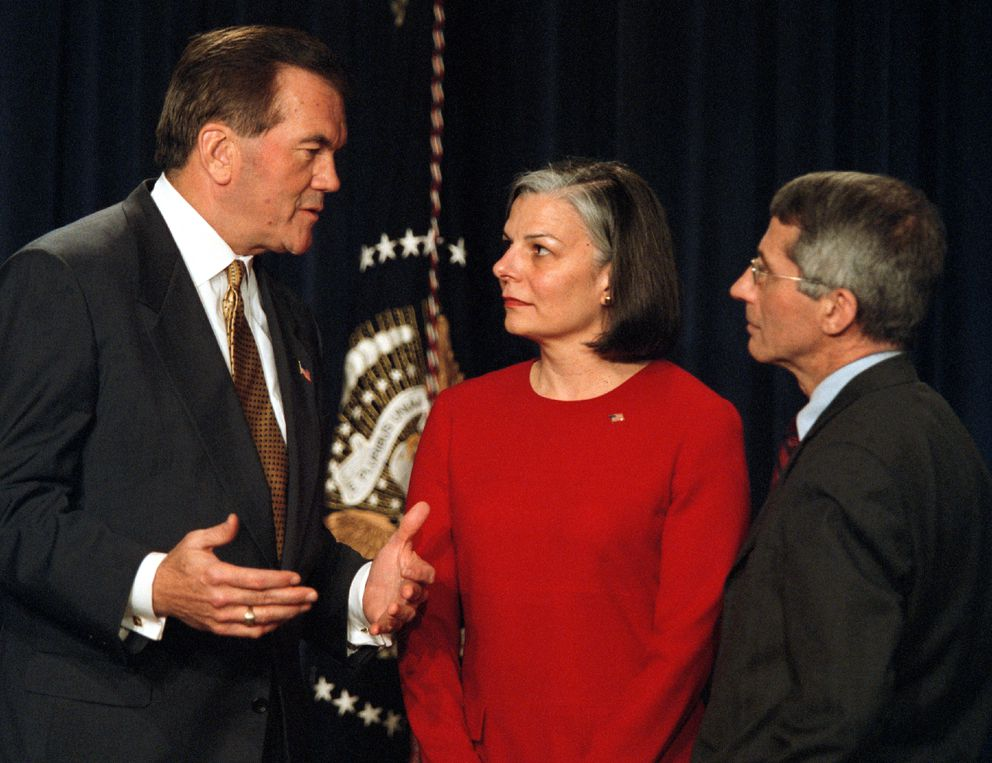 Anthony Fauci, right, talks with Homeland Security Director-desigee Tom Ridge and Julie Gerberding, the director of Centers for Disease Control and Prevention, in 2002. (Washington Post photo by Rich Lipski)
