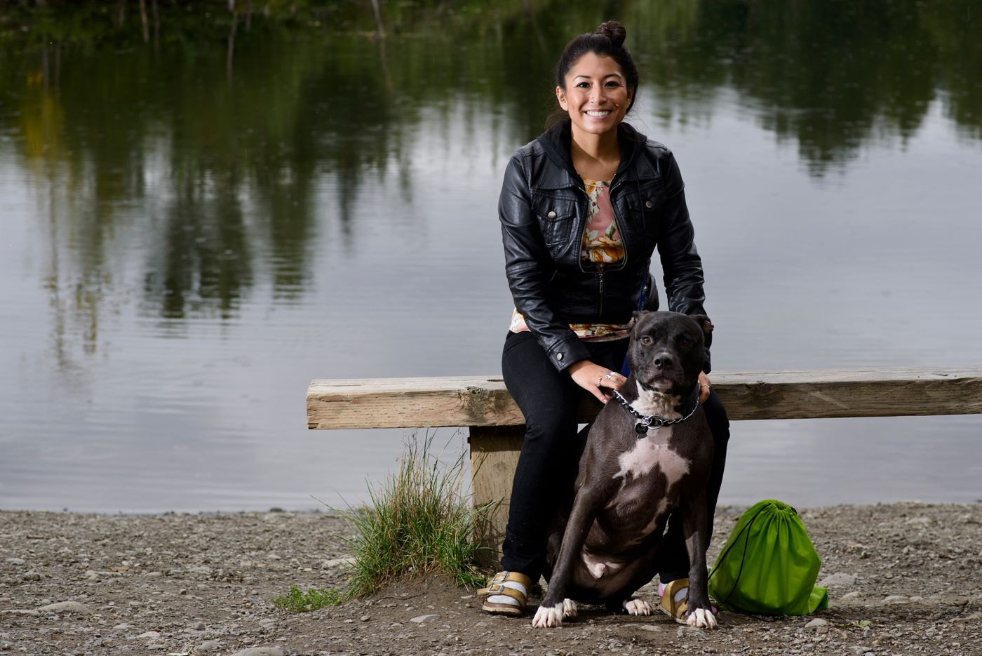 Lindsey Bartels and her American pit bull, Packer, visit the University Lake Dog Park on August 23, 2017. (Marc Lester / Alaska Dispatch News)