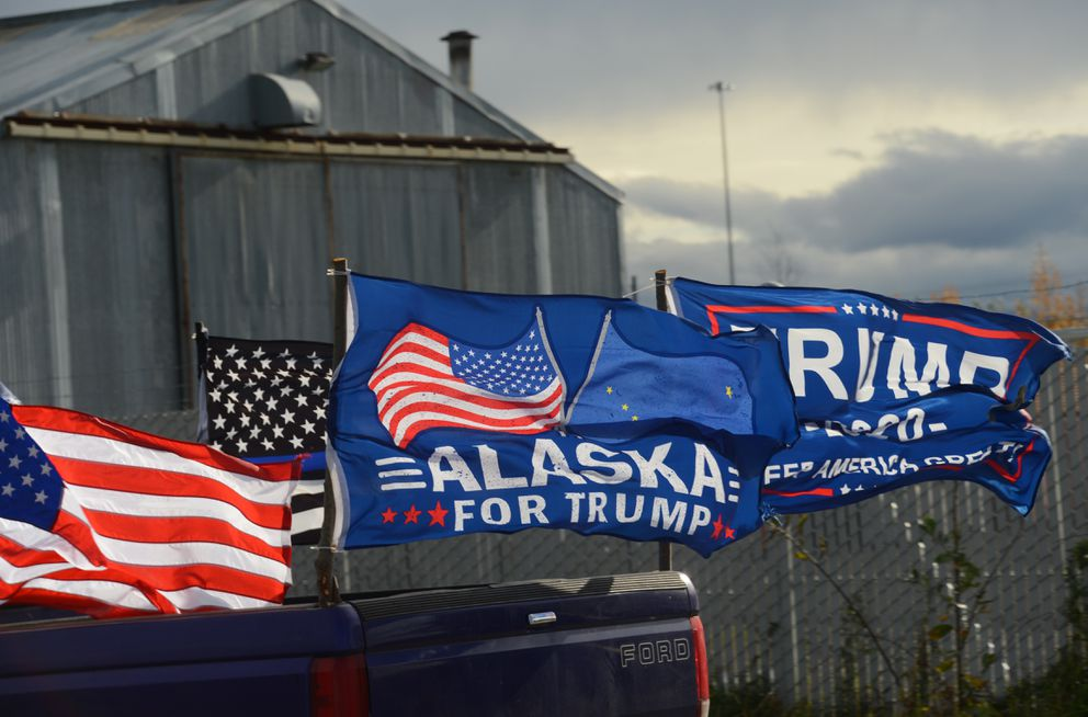A truck bears an 'Alaska for Trump ' flag as it participates in a convoy supporting President Donald Trump's re-election campaign on Saturday, Oct. 3, 2020. (James Brooks / ADN)