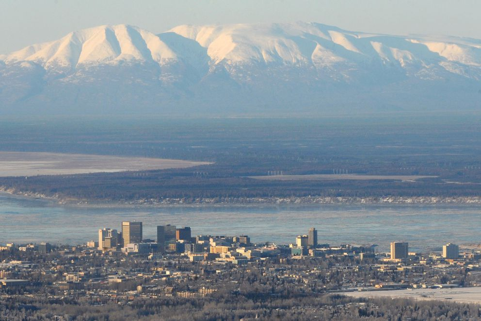 Bill Roth / Alaska Dispatch News Aerial view of the Anchorage skyline and Mt. Susitna in the distance on Wednesday, Jan. 21, 2015.