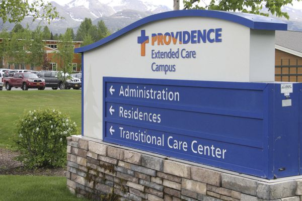 A sign directs traffic to various buildings on the Providence Extended Care campus in Anchorage, Alaska, Monday, June 1, 2020. Officials say the nearby Providence Transitional Care Center has had 17 coronavirus cases since a resident tested positive on Friday, May 29. (AP Photo/Mark Thiessen)