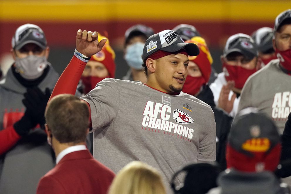 Kansas City Chiefs quarterback Patrick Mahomes celebrates with teammates after the AFC championship NFL football game against the Buffalo Bills, Sunday, Jan. 24, 2021, in Kansas City, Mo. The Chiefs won 38-24. (AP Photo/Charlie Riedel)