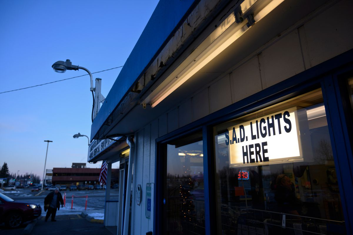 Lake Otis Medical Supply advertises its supply of S.A.D. lights with a sign on the store on December 19, 2019. (Marc Lester / ADN)