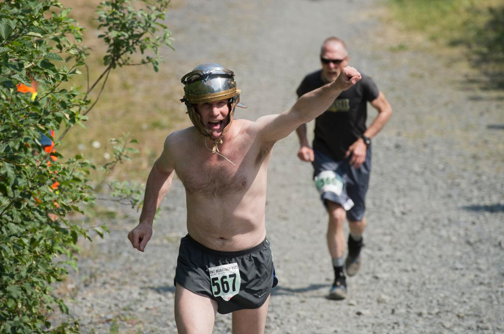Steve Carroll of Anchorage lets out a yell in the Mount Marathon men's race on July 4, 2019, in Seward. (Marc Lester / ADN)