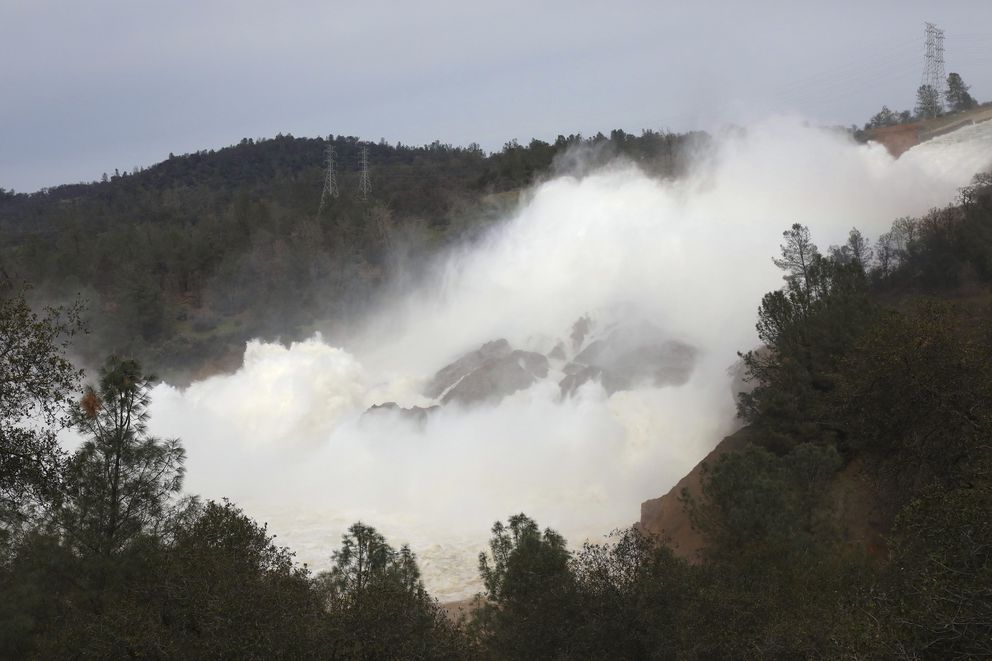 Water flows down the damaged spillway at the Oroville Dam in Oroville, Calif., on Monday. (Jim Wilson/The New York Times)