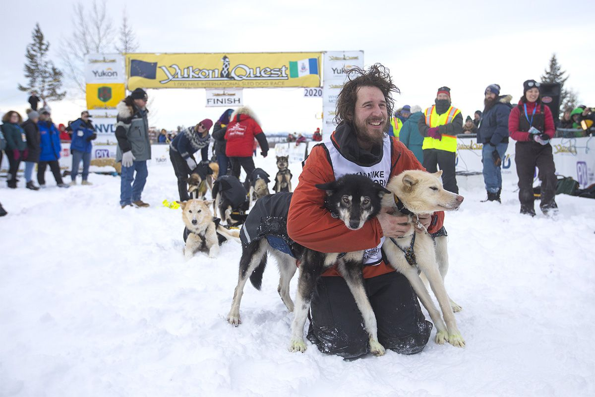 Brent Sass poses with his lead dogs after crossing the finish line in Whitehorse on Feb. 11 to win his third Yukon Quest. (Crystal Schick / Yukon News)