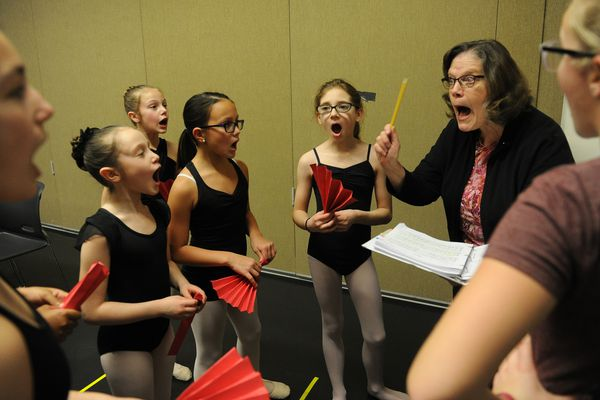 "Janet Carr-Campbell works with local dancers on a song as they rehearse at Alaska Dance Theatre for their part in the production of ""Billy Elliot"" in Anchorage, Alaska, on Saturday, Jan. 28, 2017. The play runs Feb. 14-19 at the Alaska Center for the Performing Arts in Anchorage, Alaska. (Bob Hallinen / Alaska Dispatch News)"