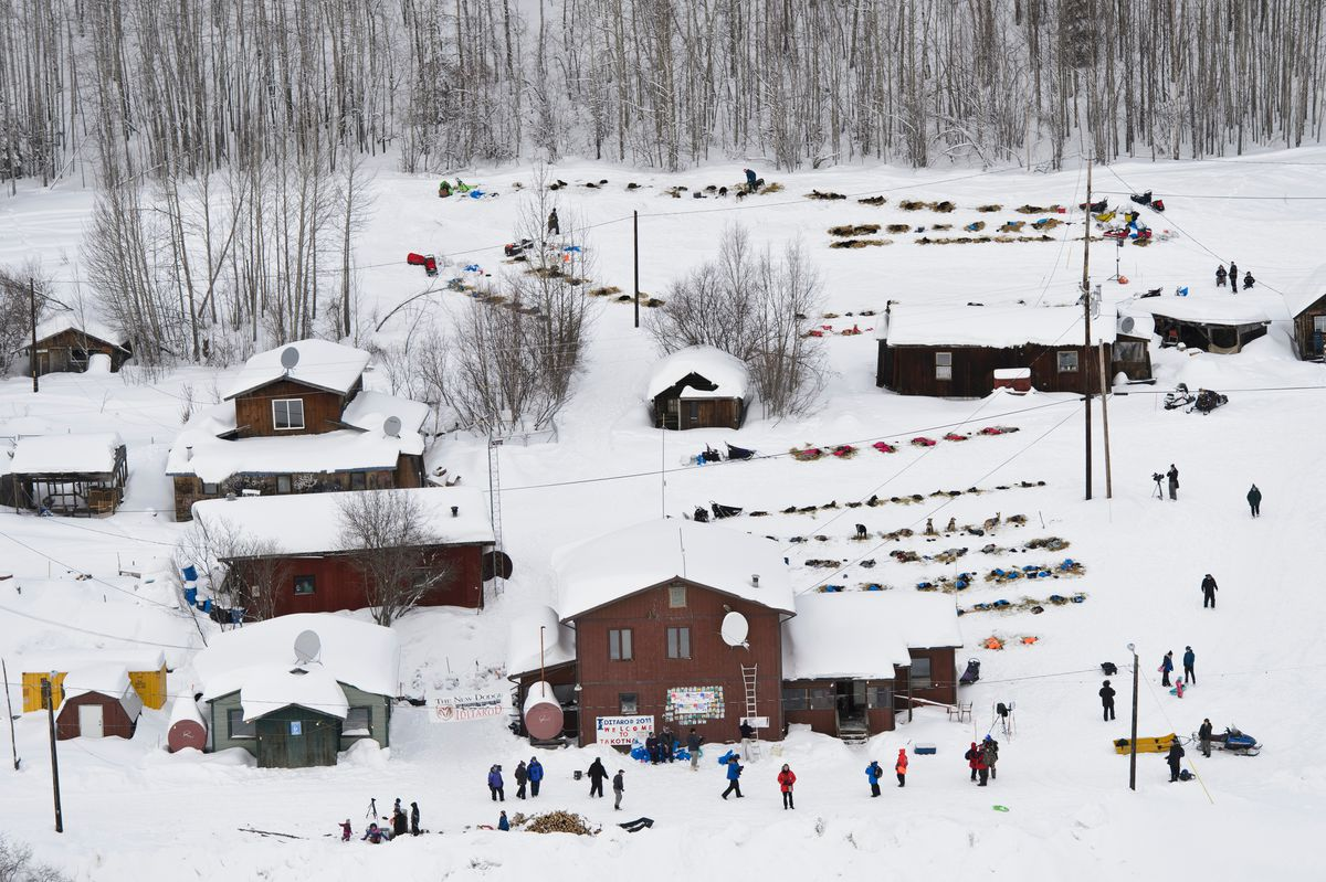 Dog teams line the hillside near the center of Takotna as many mushers take their mandatory 24-hour rest there during the Iditarod Trail Sled Dog Race on March 6, 2019. (Marc Lester / ADN)