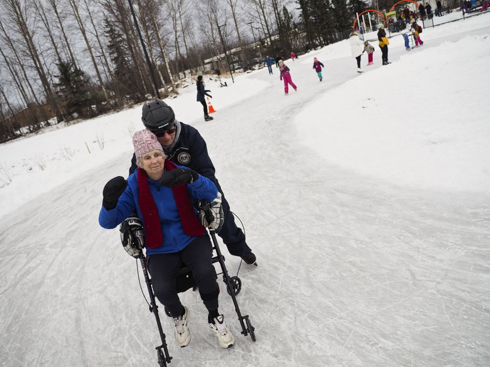 Ainslie Phillips gets pushed around the ice skating ribbon at Chanshtnu Muldoon Park by Don Wood in January 2018. (Marc Lester / ADN archive)