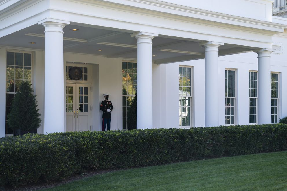A Marine is posted outside the West Wing of the White House, signifying the President is in the Oval Office, Thursday, Nov. 5, 2020, in Washington. (AP Photo/Evan Vucci)