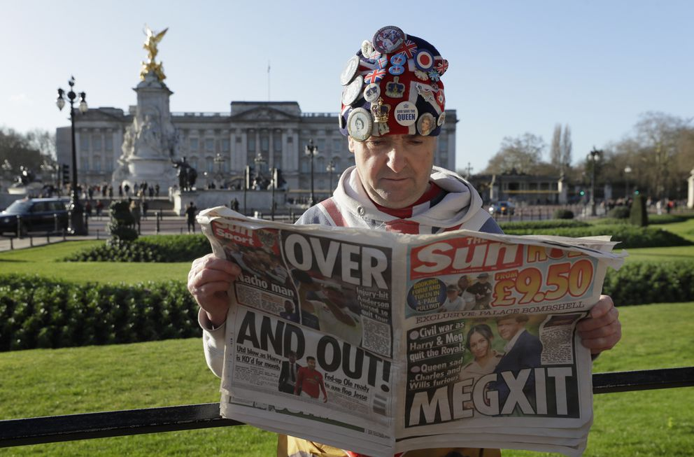 Self-proclaimed royal super-fan John Loughrey poses for the media backdropped by Buckingham Palace in London, Thursday, Jan. 9, 2020. In a statement Prince Harry and his wife, Meghan, said they are planning 'to step back ' as senior members of the royal family and 'work to become financially independent. '(AP Photo/Kirsty Wigglesworth)