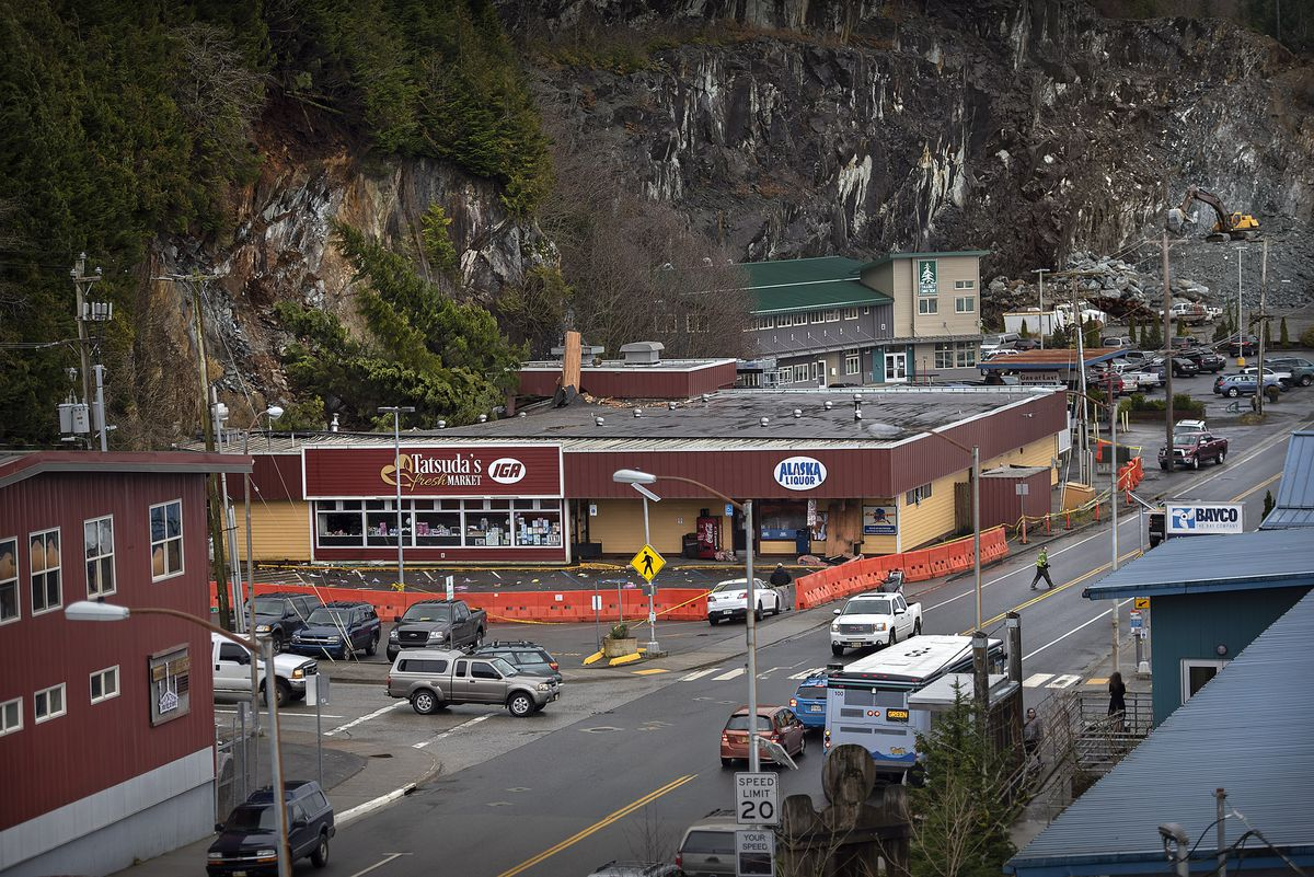 The Tatsuda's IGA building in Ketchikan, Alaska was condemned Feb. 27, 2020 after it was struck early Thursday morning by a rockslide. The main portion of the slide hit the northeast corner of the building which collapsed part of the roof and ruptured a water main causing extensive damage to both the interior and exterior. (Dustin Safranek/Ketchikan Daily News via AP)