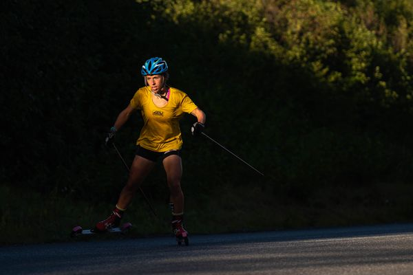 Rosie Frankowski rollerskis up Basher Drive during a time trial Friday, Sept. 4, 2020. The Alaska Pacific University's elite-level skiers were finishing the third day of time trials, intended to simulate a three-day World Cup stage race. (Loren Holmes / ADN)