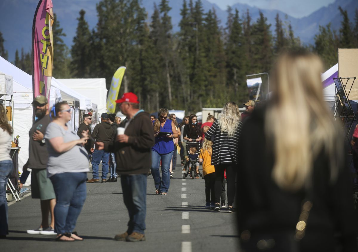 People attend the Mat-Su Fall Festival at the Alaska Raceway Park in Palmer on Aug. 28, 2020. (Emily Mesner / ADN)