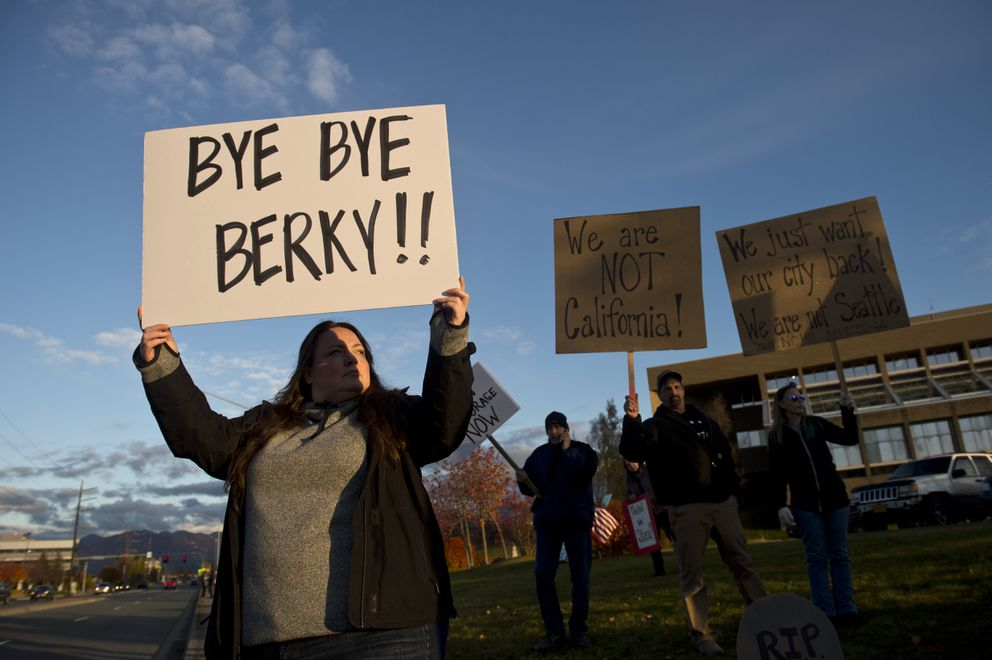 Sara Boyer holds a sign along 36th Avenue outside the Loussac Library while the Anchorage Assembly meets on October 13, 2020. The resignation of Anchorage Mayor Ethan Berkowitz was announced at the meeting. (Marc Lester / ADN)