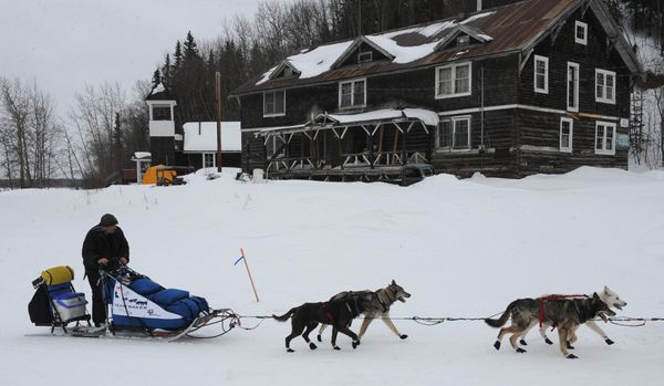 Iditarod champion John Baker arrives at the Anvik checkpoint on Friday, Mar. 8, 2013. (Bill Roth / ADN archive 2013)