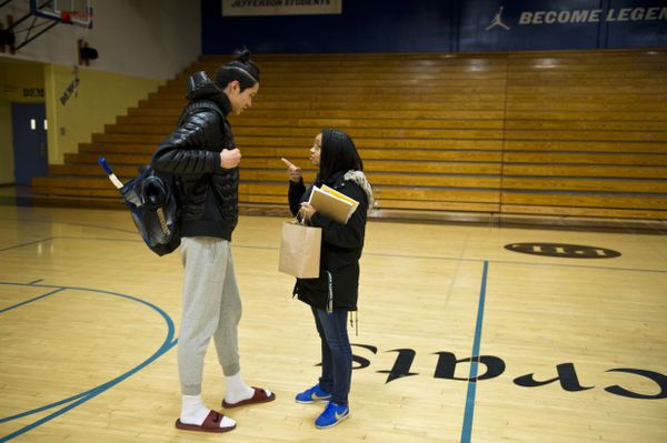 """Sara Lawrence, right, tells Kamaka Hepa to stay out of trouble before he leaves the gym at Jefferson High School. """"He's one of my good students,"""" said Lawrence, of Self-Enhancement Inc., which works in the school to provide support services for students. (Marc Lester / ADN)"""