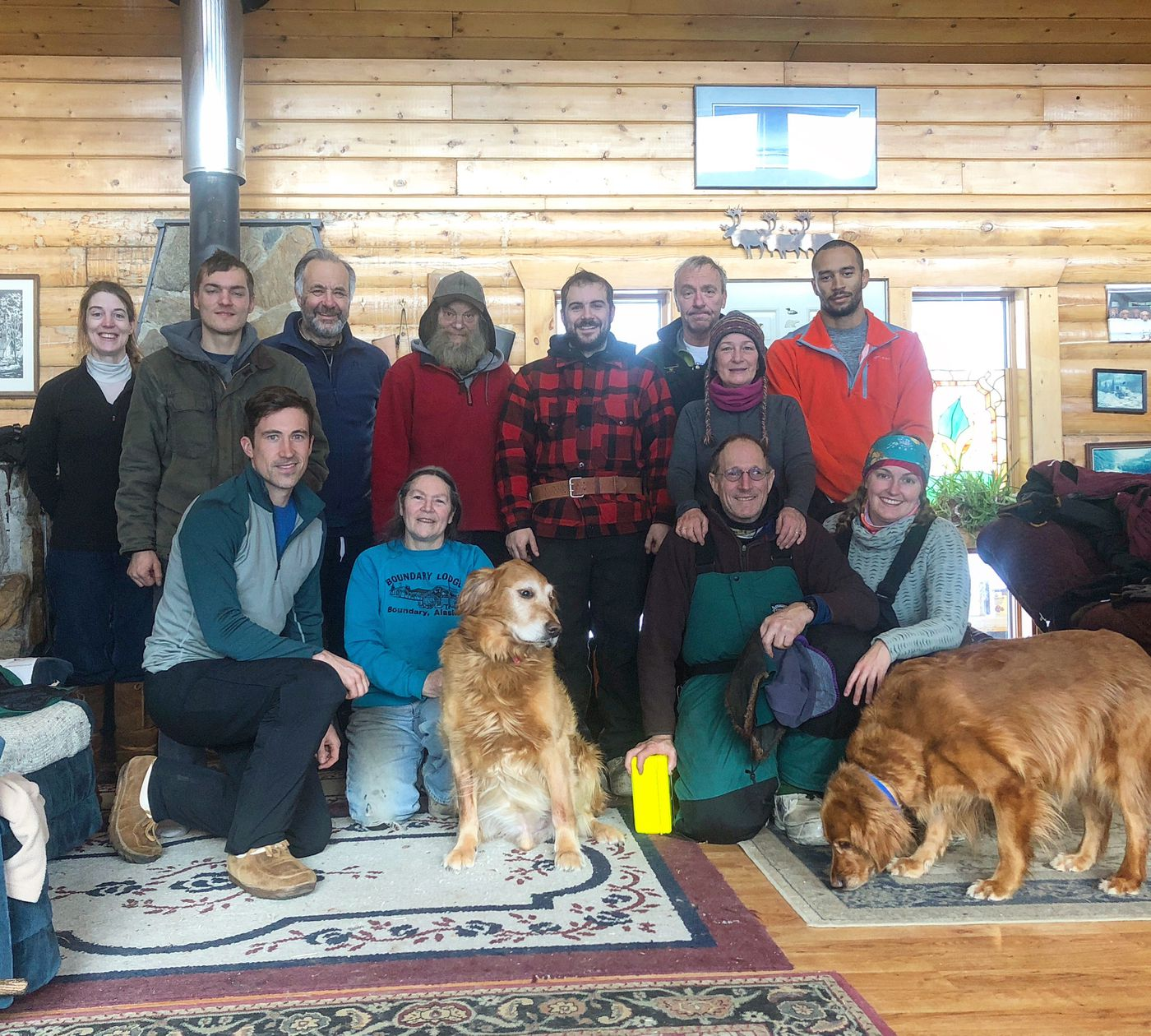 Volunteers who assisted with musher Jason Campeau's rescue from the Yukon Quest gathered for a photo in February 2018. Standing in back from left are Krystie DePue, Joel Helmer, Martin Randle, David Likins, Daniel Helmer, Craig Jones, Connie Anthony and Brandon Sipho. Front row from left: Ben Turman, Teresa (last name not confirmed), Joe Durrenberger and Kinzea Jones. (Kinzea Jones photo)