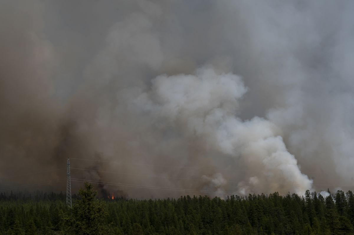 A forest fire rages outside Atka, Russia, in July. Advocacy groups say a shifting climate has already started to affect hunting, fishing and herding in indigenous areas. (Washington Post photo by Michael Robinson Chavez)