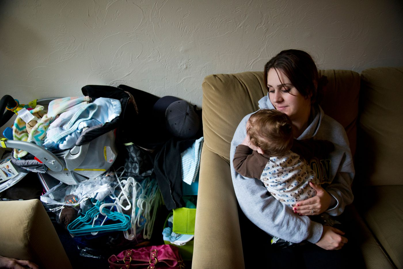 "Chantel Epstein tends to her infant son, Jakob, in her Juneau home. Epstien said she supported her heroin addiction with criminal behavior, which led her to prison. Though she has more than five years of sobriety now, her addiction changed her life in lasting ways. ""The big impact is that I'm a felon,"" she said. ""I'm never going to get a good job."""