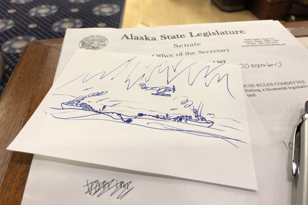 This sketch by an unnamed Alaska senator during the debate over House Concurrent Resolution 101 is seen Monday, June 10, 2019 in the Senate chambers. It depicts two fishing boats entangled and pulling in opposite directions. (James Brooks / ADN)