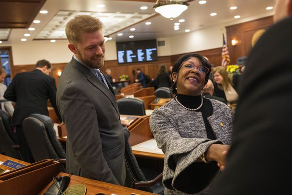 Rep. Sharon Jackson, R-Eagle River, is congratulated by a colleague after she took the oath of office from House Speaker Pro Tempore Rep. Neal Foster Thursday, Jan. 17, 2019 at the Alaska State Capitol. At left is Rep. Josh Revak, R-Anchorage. (Loren Holmes / ADN)
