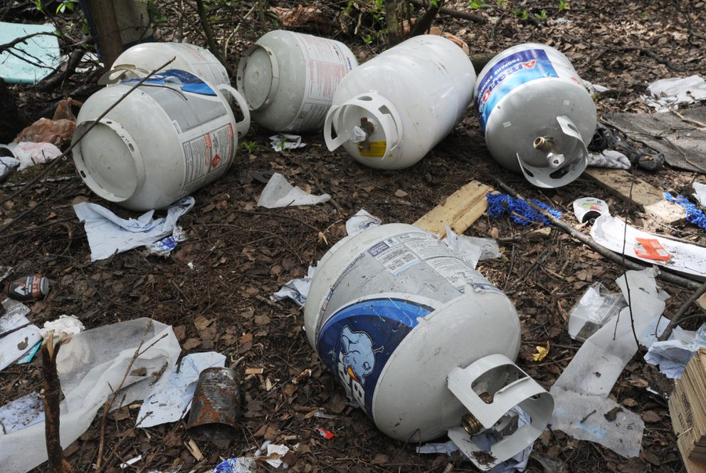 Propane tanks are scattered among the homeless camps along the Chester Creek Trail. (Bill Roth / ADN)
