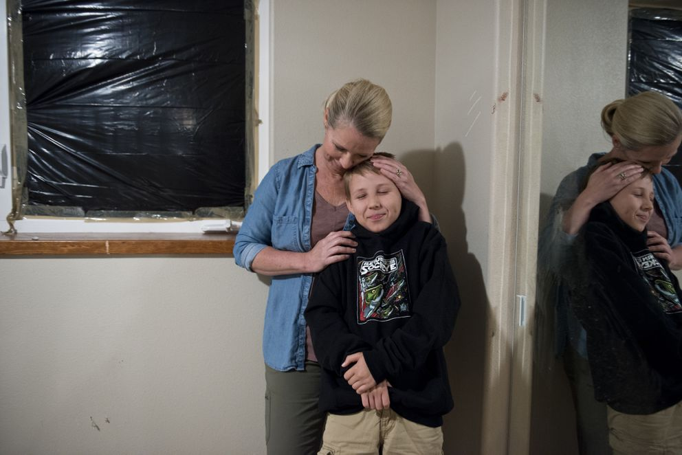 Eleven-year-old Zach Landis was in his bedroom on June 26 when a black bear smashed through the window. He was uninjured. He is standing in the room with his mother, Alisa Landis, two days later. (Marc Lester / Alaska Dispatch News)