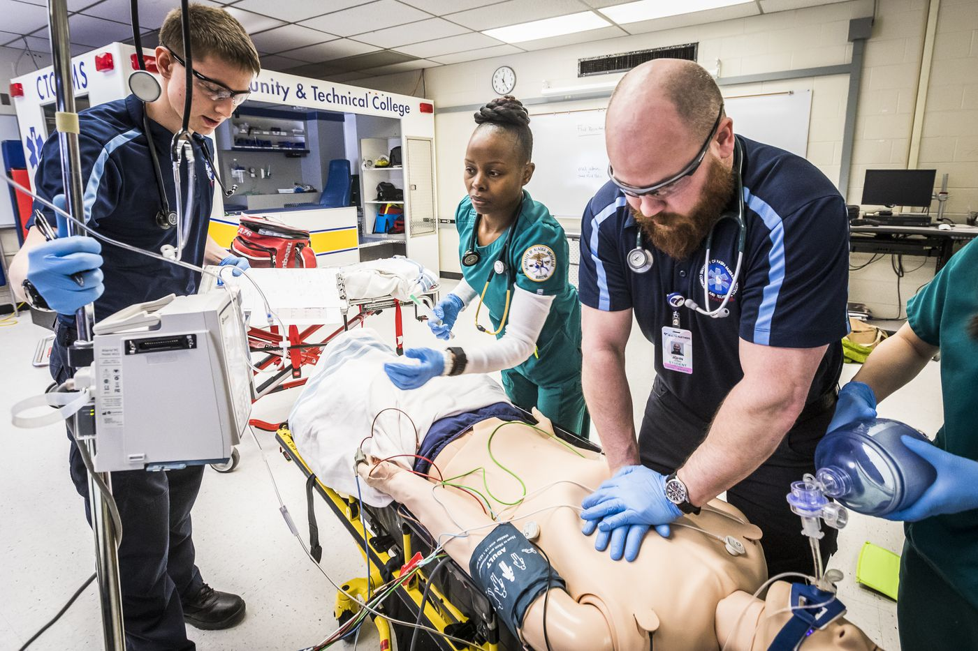 UAF CTC paramedicine students practice a patient handoff with UAA nursing students in a joint training exercise April 17, 2018, at the Fairbanks campus.