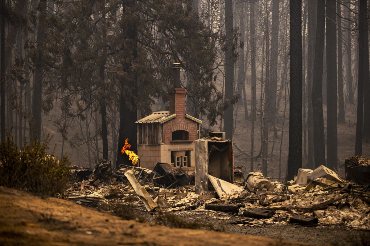 Propane gas burns at a home destroyed in the North Complex fire on Friday, Sept. 11, 2020 in Berry, California. (Brian van der Brug/Los Angeles Times/TNS)