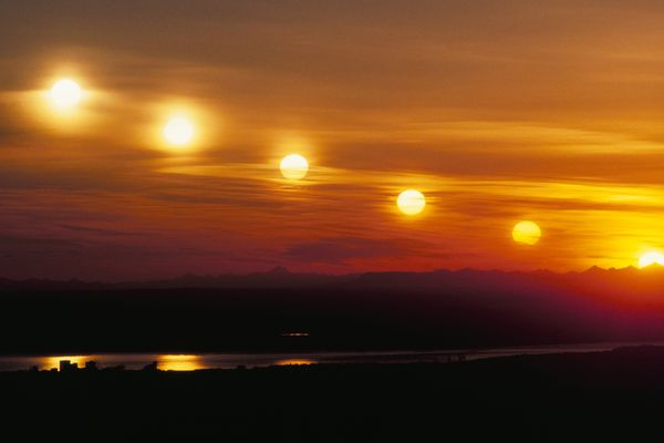 The summer sun sets over the Anchorage skyline in a multiple exposure photograph from the platform at the Glen Alps entrance to Chugach State Park. The sun was photographed at 10 minute intervals from 10:50 pm though moments before sunset at 11:40 p.m. Thursday night (June 20, 1991). The summer solstice occurs June 21, when the sun will set five seconds later, at 11:42 p.m. (Paul Souders / Anchorage Daily News) 910620