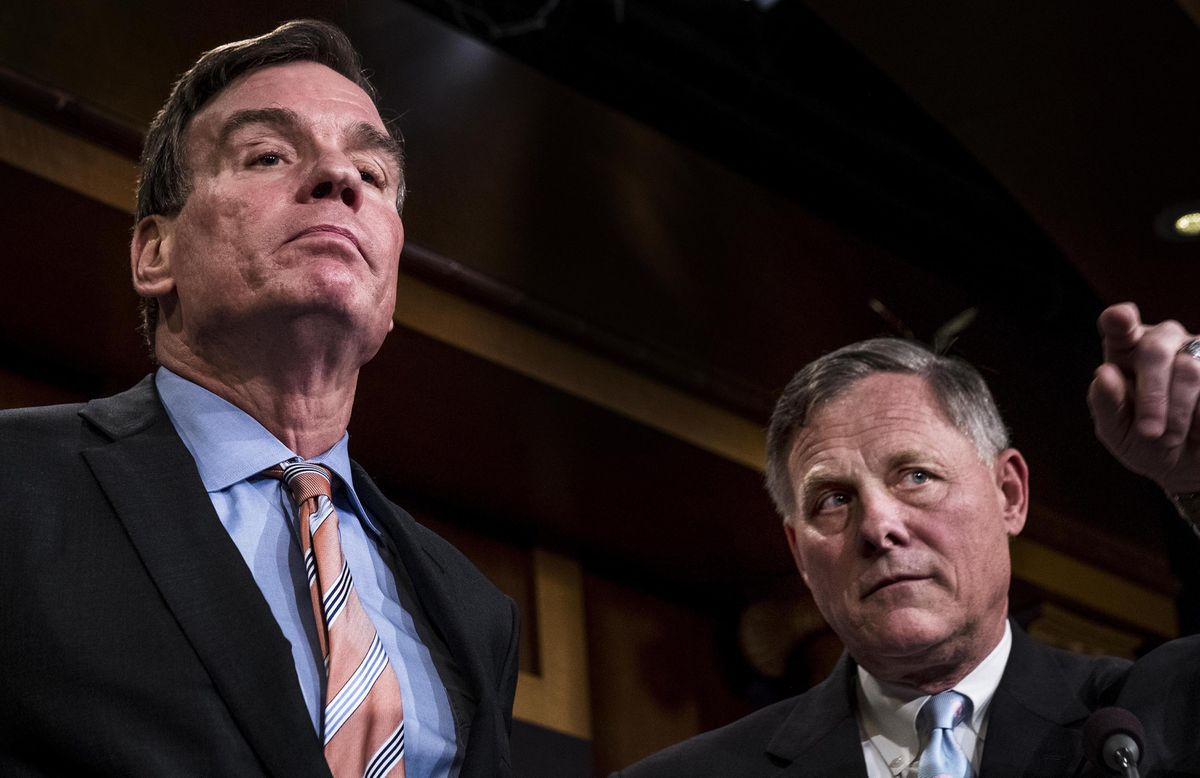 Senate Intelligence Committee Vice Chairman Mark Warner, D-Va., left, and committee Chairman Richard Burr, R-N.C., right, speak during a March 2017 news conference on Capitol Hill. (Washington Post photo by Melina Mara)