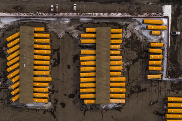 School busses are parked at the Anchorage School District transportation center on Friday, March 27, 2020. Schools have been ordered temporarily closed due to the coronavirus pandemic. (Loren Holmes / ADN)