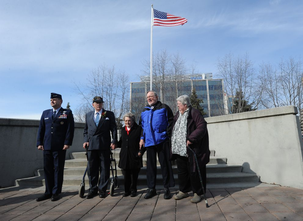 George Miller, second from left, received a Distinguished Flying Cross during a presentation at the Anchorage Veterans Memorial on Monday, April 29, 2013, 68-years after Miller earned the medal while on a bombing mission over Austria in a B-24 Liberator during World War II. (Bill Roth / ADN)