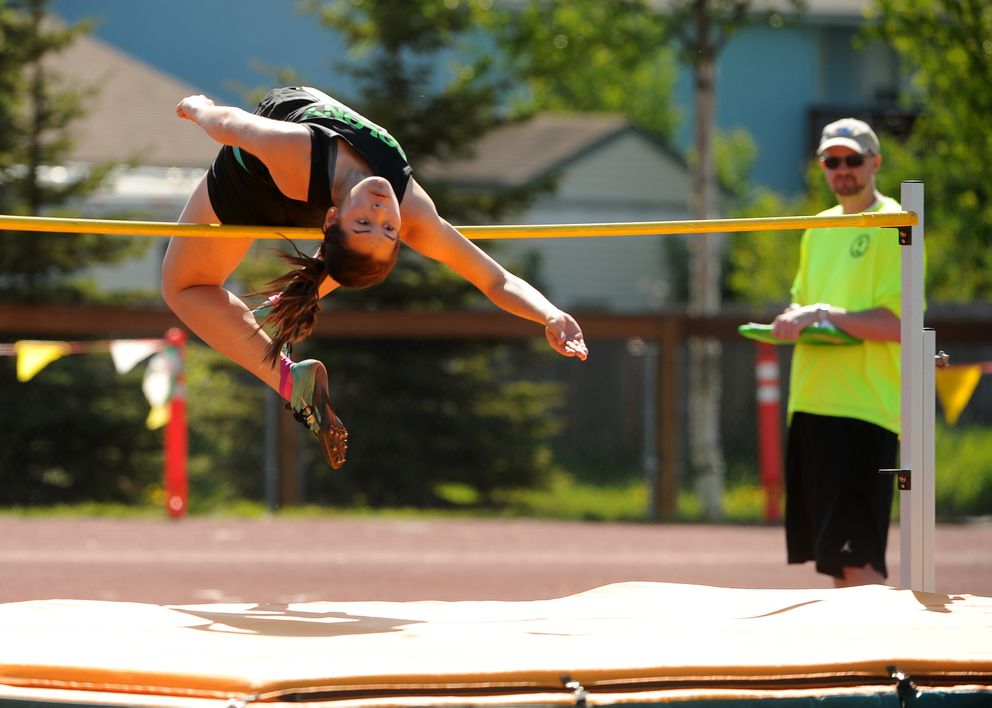 Madeline Ko of Colony clears the bar during the high jump. (Bob Hallinen / Alaska Dispatch News)