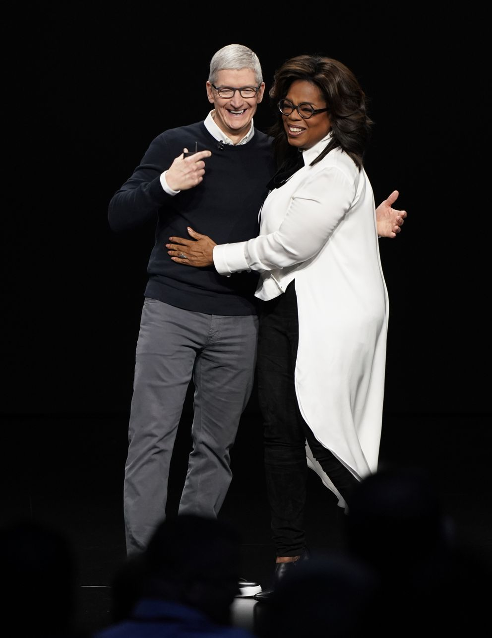 Apple CEO Tim Cook and Oprah Winfrey at the Steve Jobs Theater during an event to announce new products Monday, March 25, 2019, in Cupertino, Calif. (AP Photo/Tony Avelar)